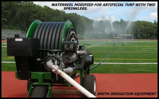Waterreel with booster pump cools artificial turf field.