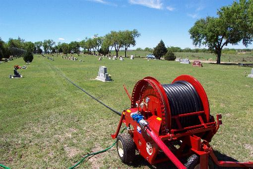 Traveling sprinkler irrigation on cemeteries.