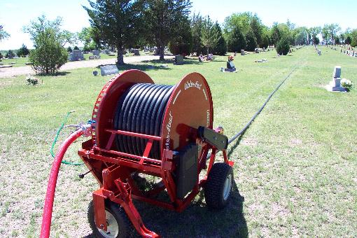 Waterreels irrigate cemeteries and parks