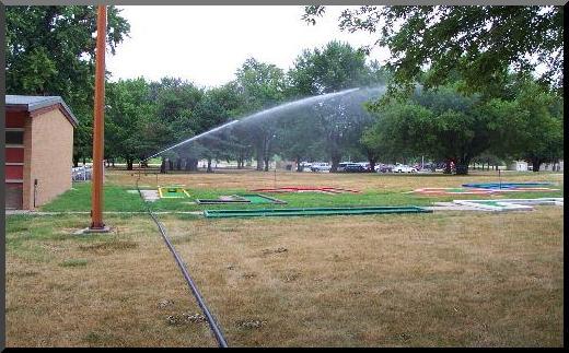 Waterreel irrigate around trees, buildings, etc.