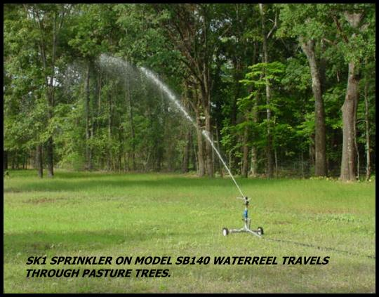 Sime K1 sprinkler package on SB140 waterreel easily travels through wooded pasture.
