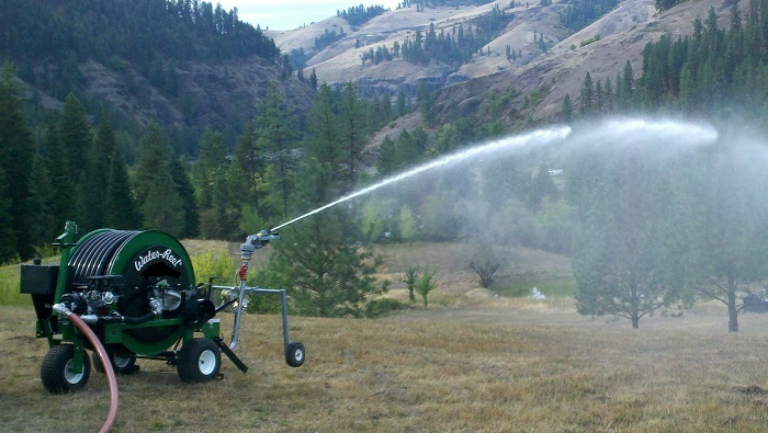 Model T200S KIFCO waterreel with 9 H.P. Honda  booster pump irrigates new seeded hay field.