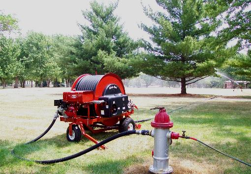 Model ST200P waterreel irrigates facility grounds with trees