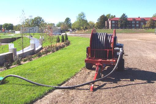 Traveling sprinklers irrigate parks and grounds